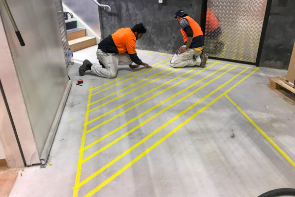 MJS Painting applying floor markings using dulux road paint in Christchurch